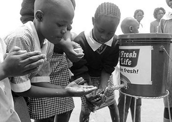 In honor of 2014 Genesis Prize Laureate, Michael Bloomberg, The Genesis Prize Foundation gave grants to nine social entrepreneurial teams. Sanergy was a grant recipient; this image shows children in the Mathare slum in Nairobi, Kenya using sanitation solutions developed by Sanergy