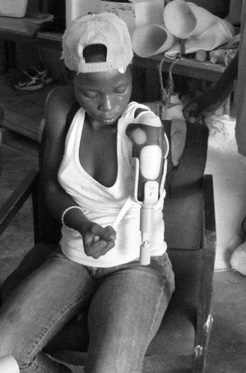 In honor of 2014 Genesis Prize Laureate, Michael Bloomberg, The Genesis Prize Foundation gave grants to nine social entrepreneurial teams. Enable Community Foundation Haiti  was a grant recipient; this image shows a woman being fitted for a 3D-printed prosthesis